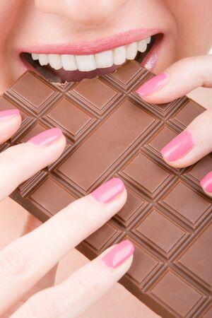 fun woman eating chocolate  photo