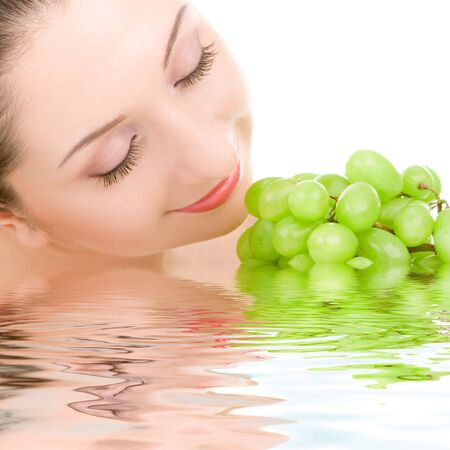 pretty woman with green grape isolated on the white background Stock Photo - 5136435