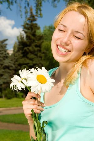 fun woman rest in the park with flowers photo
