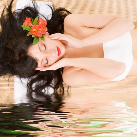 lovely brunette with flowers Stock Photo - 5178540
