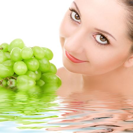 pretty woman with green grape isolated on the white background Stock Photo - 5334961