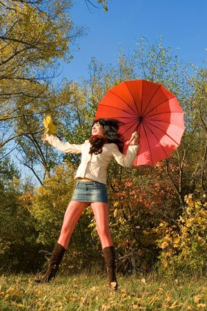 Young pretty woman in the autumn park Stock Photo - 5334980