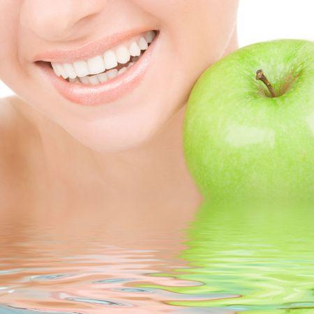 healthy teeth and green apple photo
