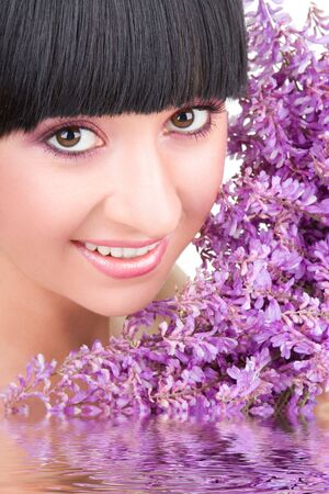 Young woman with lilac flowers Stock Photo - 5334977