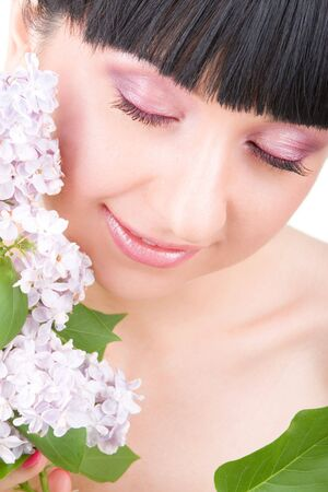 Young woman with lilac flowers Stock Photo - 5334976
