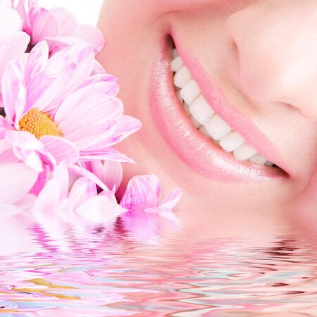 Smile of young woman with flowers photo