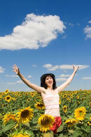 fun woman in the field of sunflowers Stock Photo - 5495889