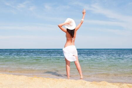 Young fashion woman on the beach Stock Photo - 5495818