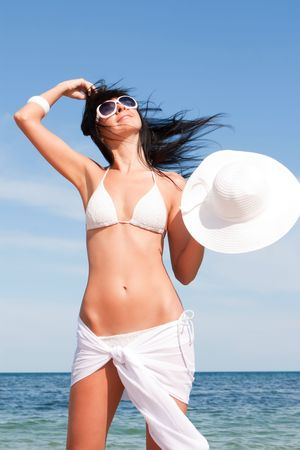 Young fashion woman on the beach Stock Photo - 5495851