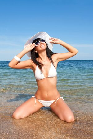 Young fashion woman on the beach Stock Photo - 5495849