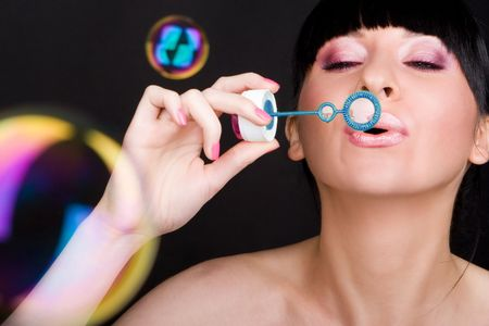 Young woman blowing soap bubble  photo
