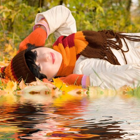 Young pretty woman on the autumn leaf  Stock Photo