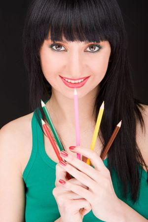 young woman with varicolored pencils Stock Photo - 5569074