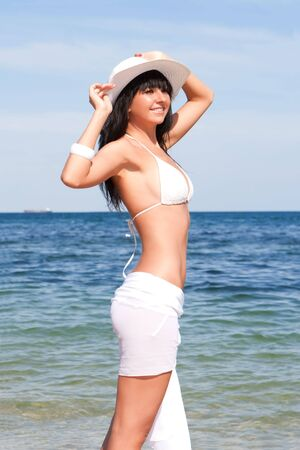 Young fashion woman on the beach Stock Photo - 5582497