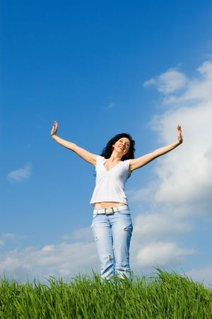 happy young woman dreams to fly on winds  photo