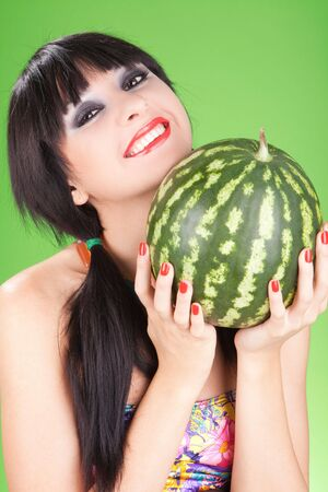fashion woman with watermelon on the green background photo