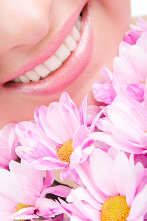 Smile of young woman with flowers Stock Photo - 5591682