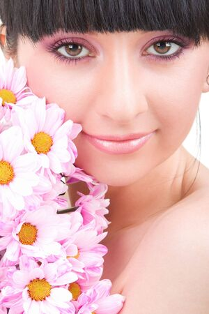 Young woman with pink flowers photo