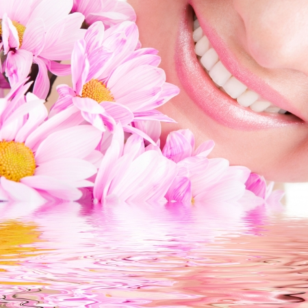 Smile of young woman with flowers