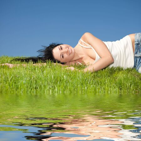 happy young woman rest on the green grass Stock Photo - 5620630
