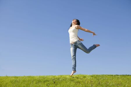 pretty young woman jumping on green grass Stock Photo - 5620618