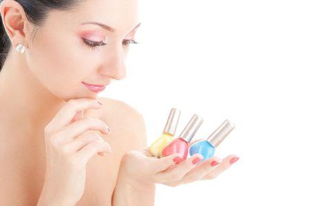 Elegant woman choose the color of nail polish photo