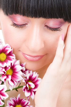 Young woman with pink flowers Stock Photo - 5635611