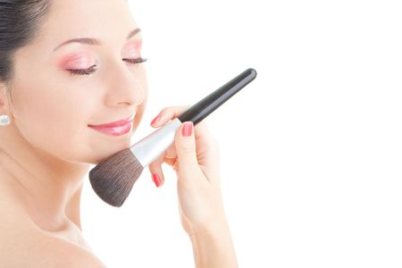 Young woman with brush for makeup