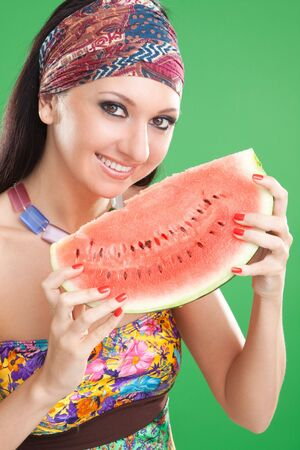 fashion woman with watermelon on the green background 