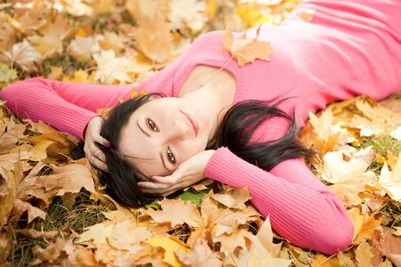 Young pretty woman rest in the autumn park photo