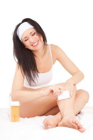 depilacion con cera: Expresi�n mujer depilaci�n piernas Foto de archivo