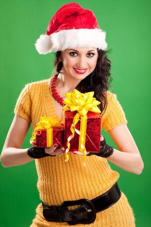 Fun santa woman with christmas gift  photo