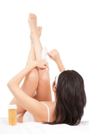 Expression woman depilating her legs  photo
