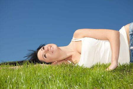 healthy person: happy young woman rest on the green grass Stock Photo