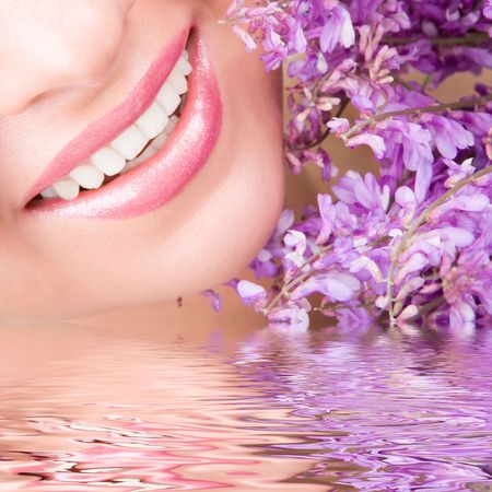Smile of young woman with flowers Stock Photo - 6250073