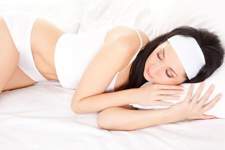 Cute woman sleeps on the white bed Stock Photo - 6250068