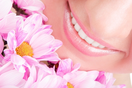 Smile of young woman with flowers Stock Photo - 6402174