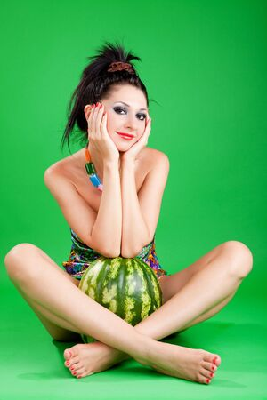 fashion woman with watermelon on the green background Stock Photo - 6402290