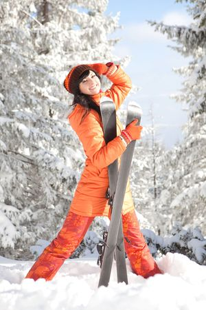 Happy girl with ski in the winter landscape photo