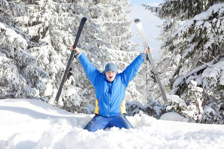 Happy man with ski in the winter landscape photo