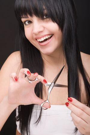 Lovely brunette with scissors of the hairdresser  photo