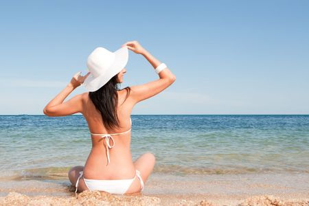 Young fashion woman on the beach    Stock Photo