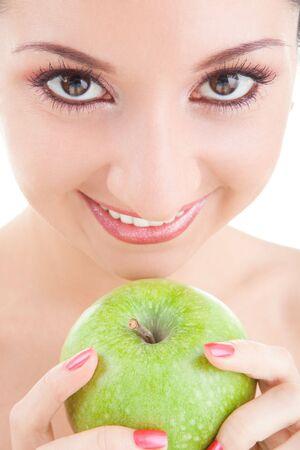 fun girl eating green apple on white background  photo
