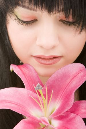 Young pretty woman with lily flower  photo