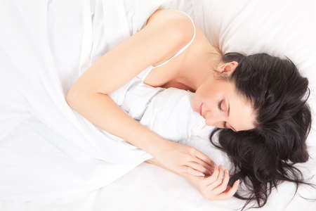Cute woman sleeps on the white bed Stock Photo - 6718352
