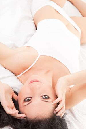Sexy woman lying on the white bed Stock Photo - 7115992