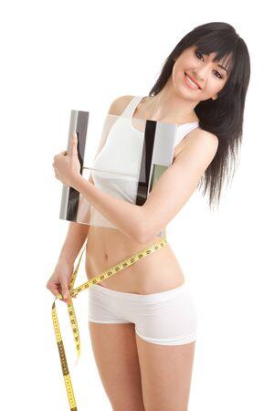 cintura perfecta: Mujer bonita con cintas de escala y medida de vidrio