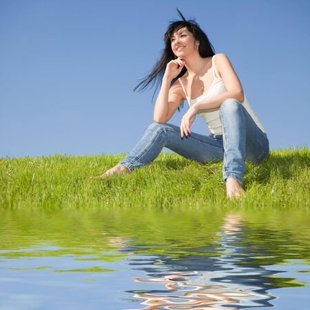 happy young woman rest on the green grass  photo