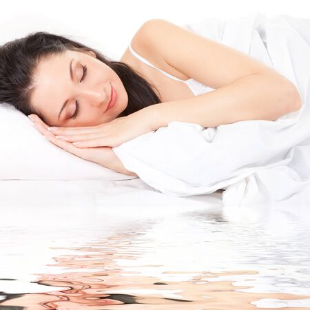 Cute woman sleeps on the white bed Stock Photo - 7225524