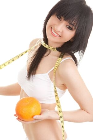 Cute woman with orange and measure tape photo